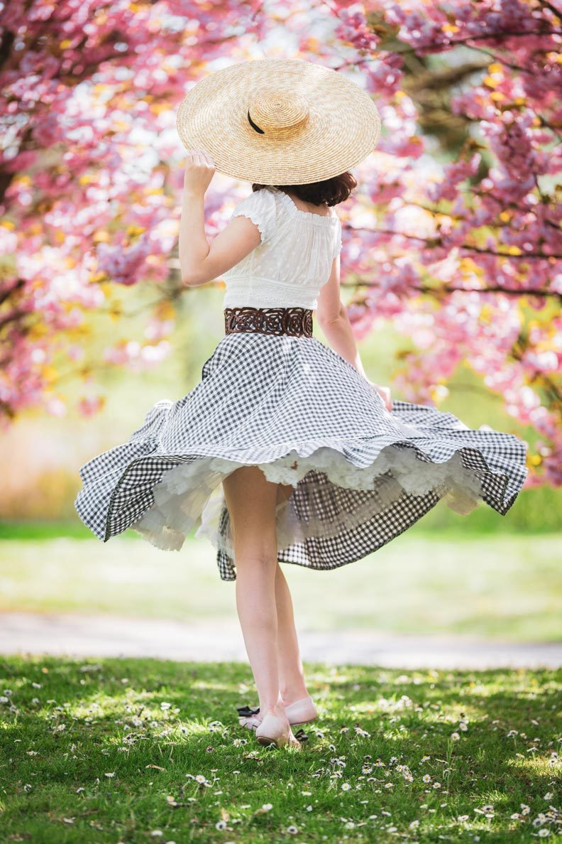RetroCat with a circle skirt by Lena Hoschek, a romantic top, and big hat