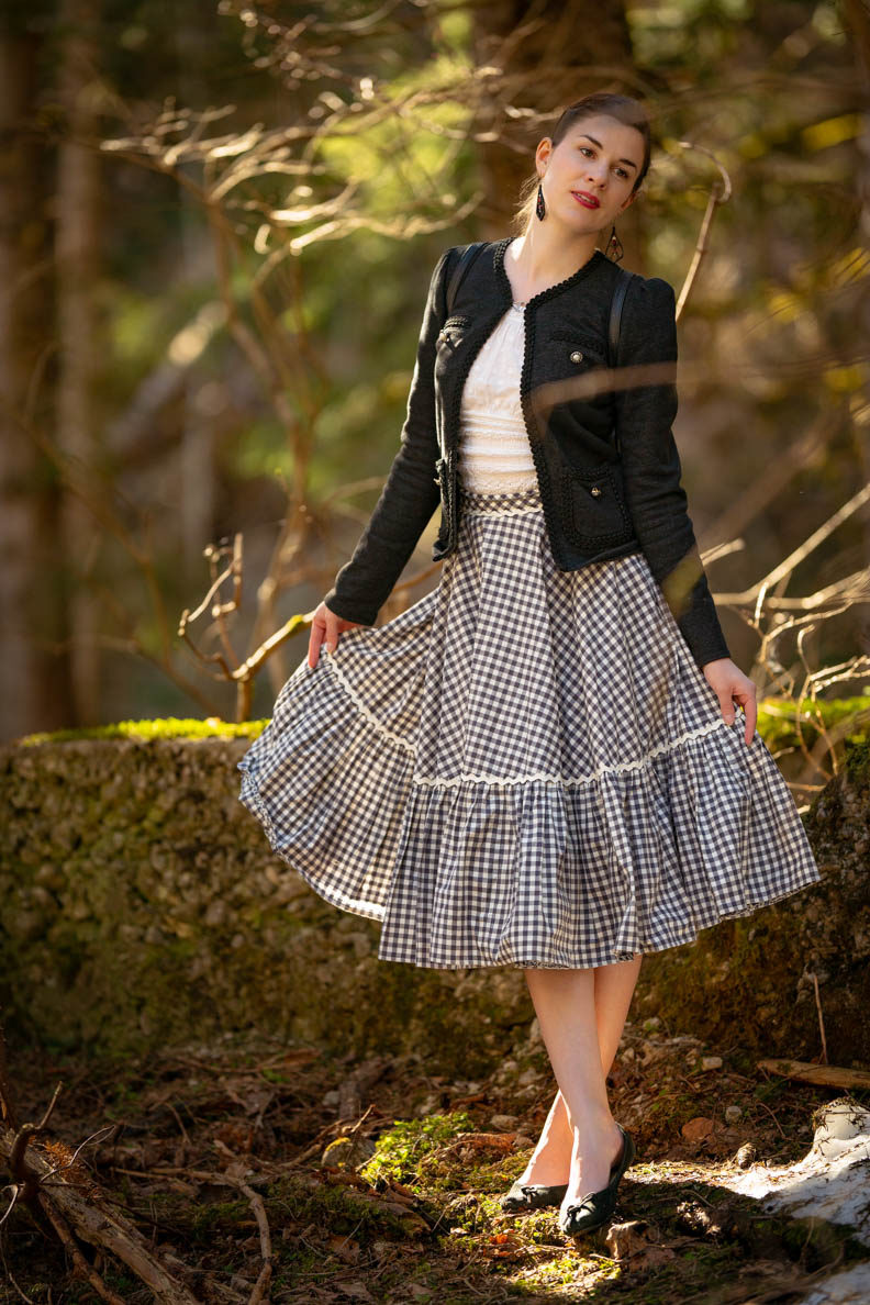 RetroCat with a skirt by Lena Hoschek and a romantic top in the woods