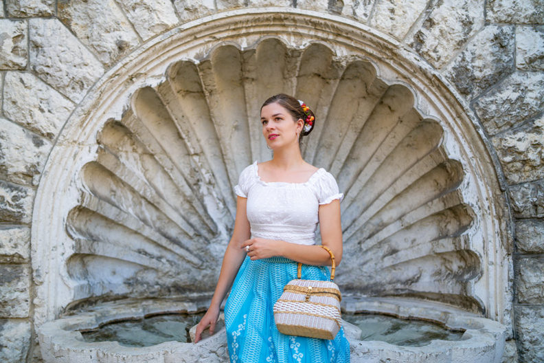 RetroCat with a romantic top, blue vintage skirt, and a basket bag