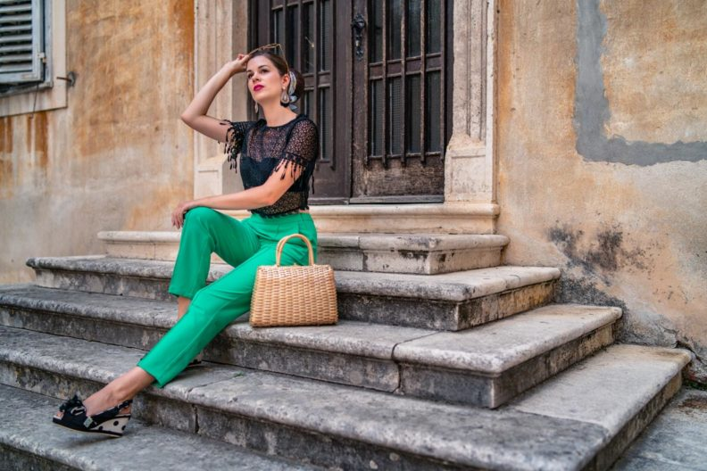 RetroCat with lace crop top by Lena Hoschek and a green cigarette pants