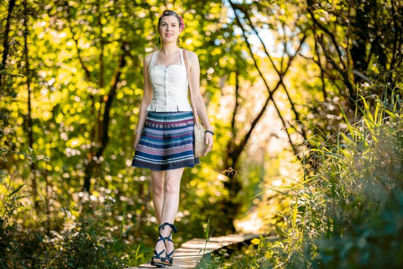 RetroCat with a Ribbon Skirt and romantic top by Lena Hoschek in the countryside