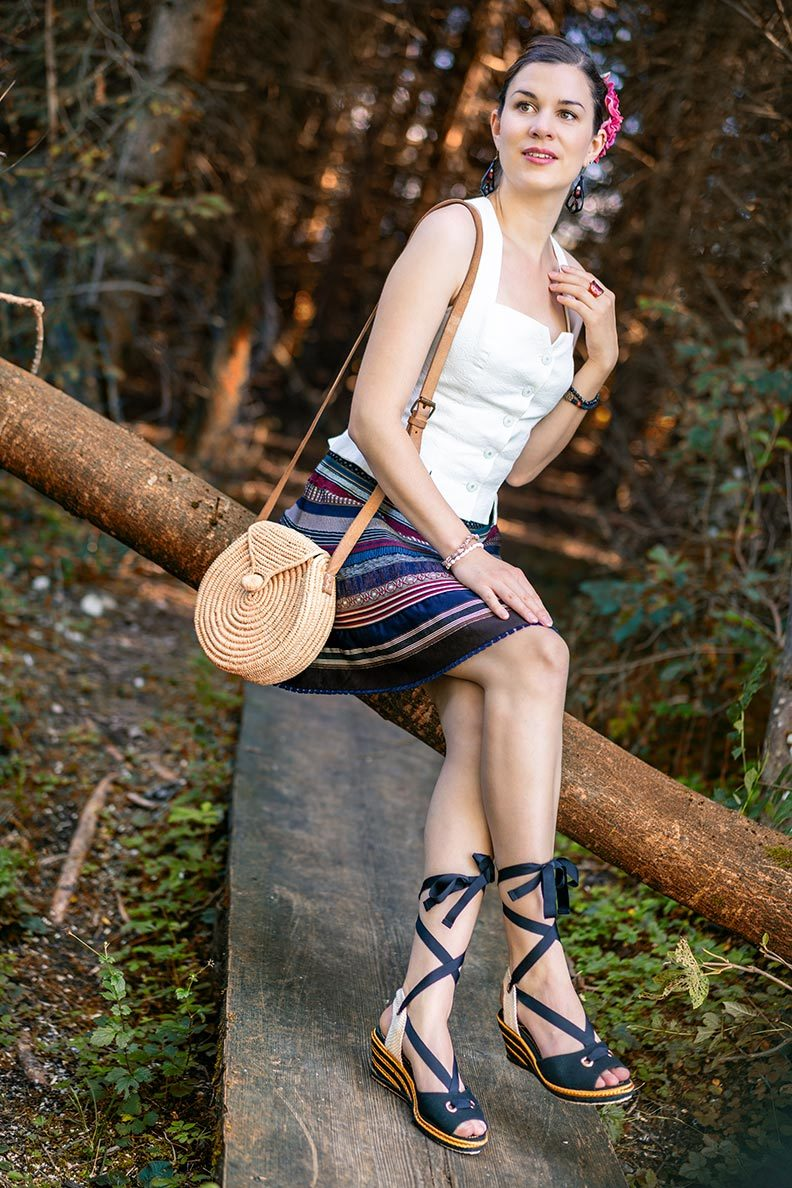 RetroCat wearing a ribbon skirt by Lena Hoschek and wedges in the forest