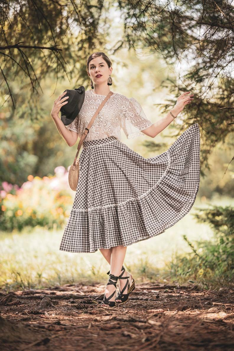 RetroCat wearing a vichy skirt by Lena Hoschek and a lace blouse in nature