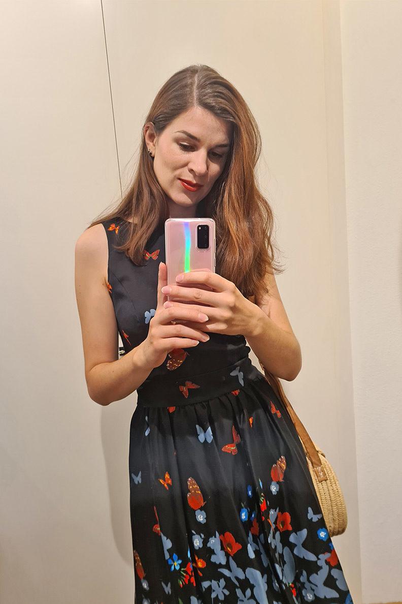 RetroCat wearing a summer dress with butterflies and a straw bag