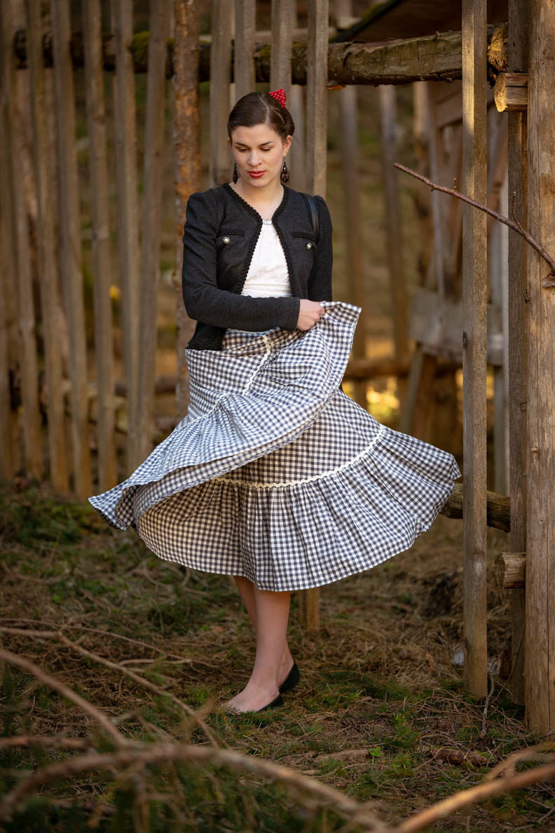 RetroCat with a circle skirt by Lena Hoschek and a traditional jacket in the forest