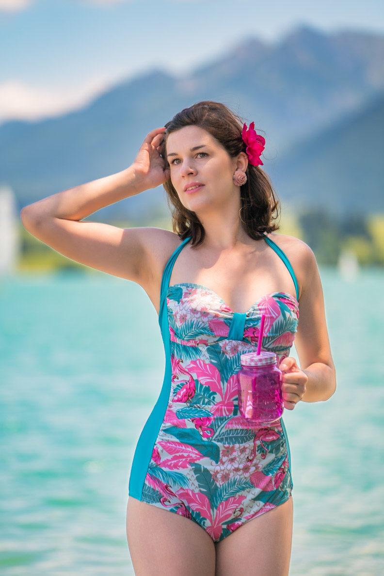 RetroCat wearing a colourful swimsuit by Bettie Page Swimwear