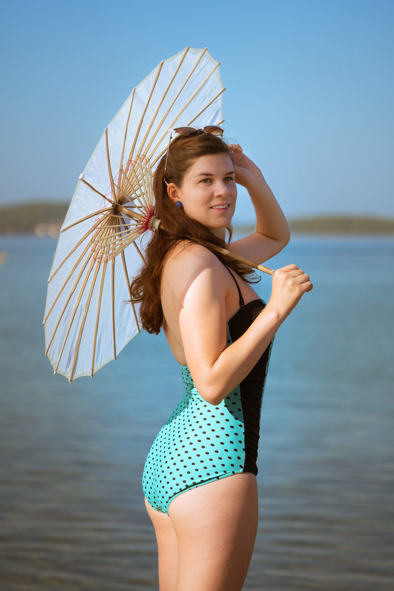 RetroCat wearing a retro swimsuit with polka-dots