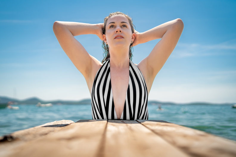RetroCat wearing a modern swimsuit with a deep neckline