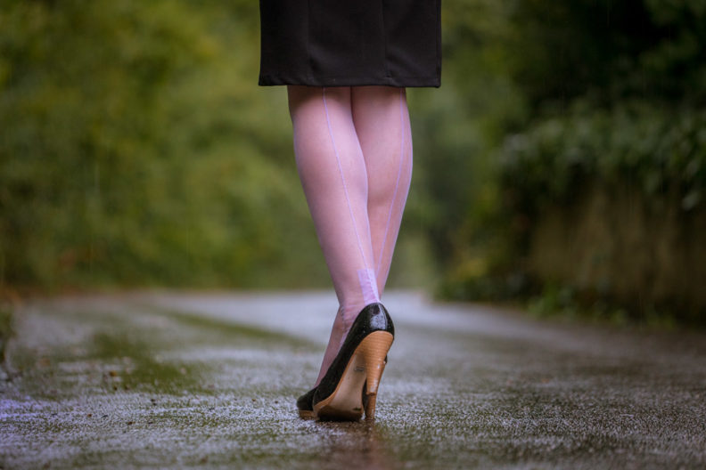 RetroCat wearing lilac nylons in the rain