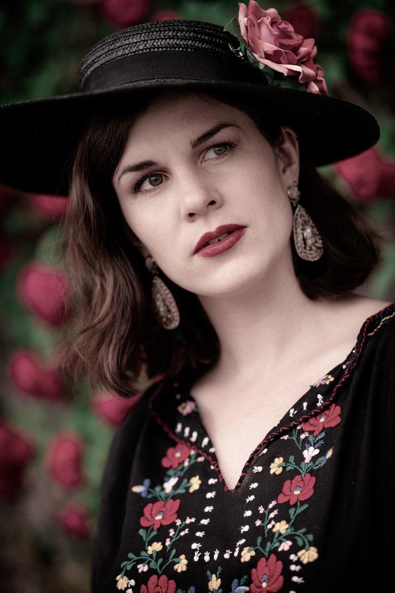RetroCat wearing a black hat with hairflowers