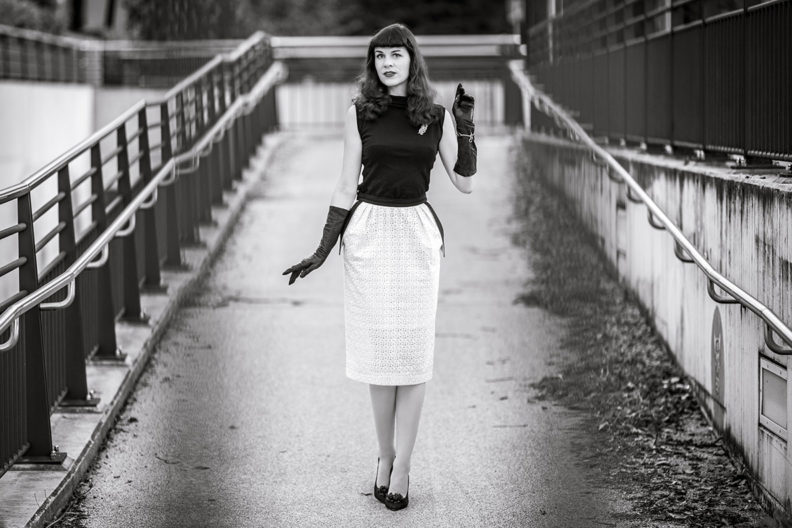RetroCat wearing a black and white look with pencil skirt, top, and high heels