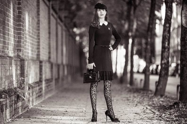 An elegant all black outfit: RetroCat wearing leopard tights and a little black dress