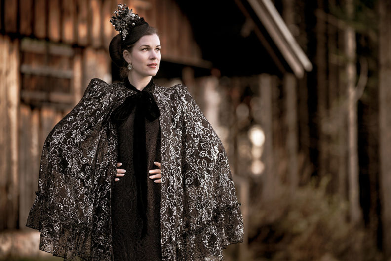RetroCat wearing a glamorous cape with lace by The Vampire's Wife x H&M