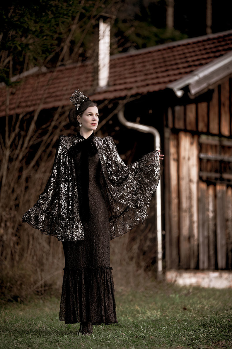 RetroCat wearing a long lace dress and a cape by The Vampire's Wife