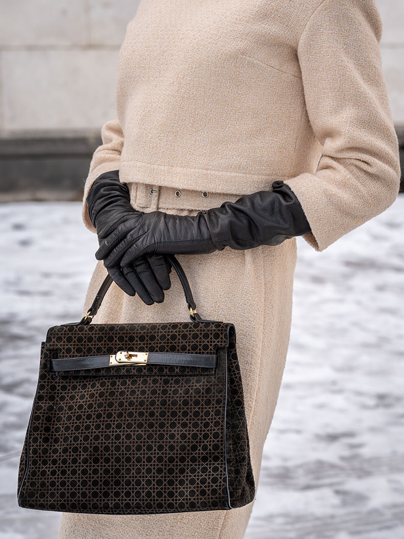 RetroCat wearing long vintage leather gloves and a vintage handbag