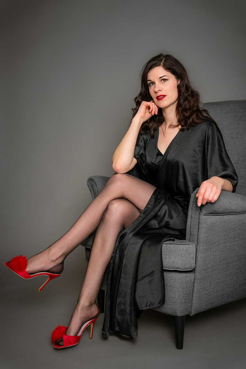 Glamorous loungewear: RetroCat wearing a lounging robe, nylons and red mules
