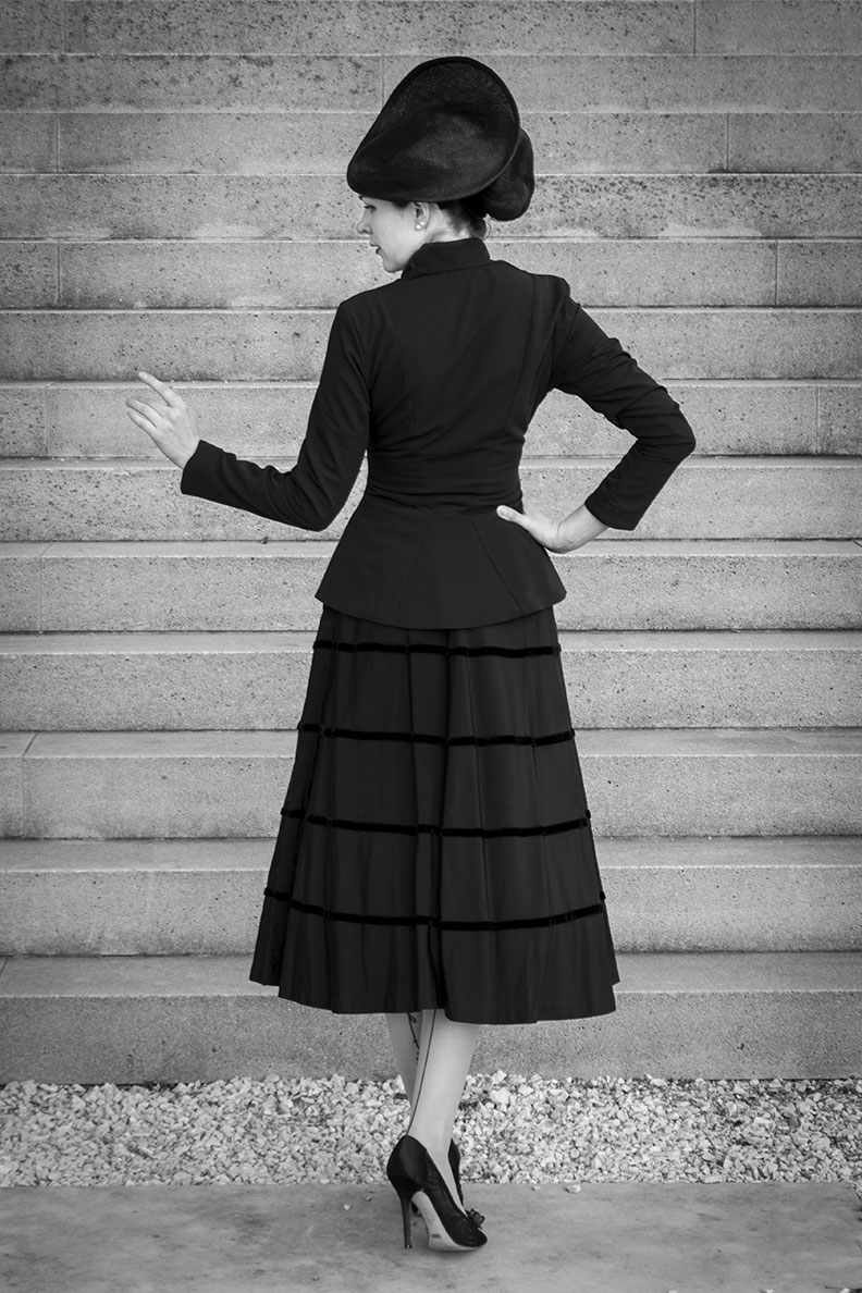 RetroCat wearing a blazer, a midi skirt and seamed tights