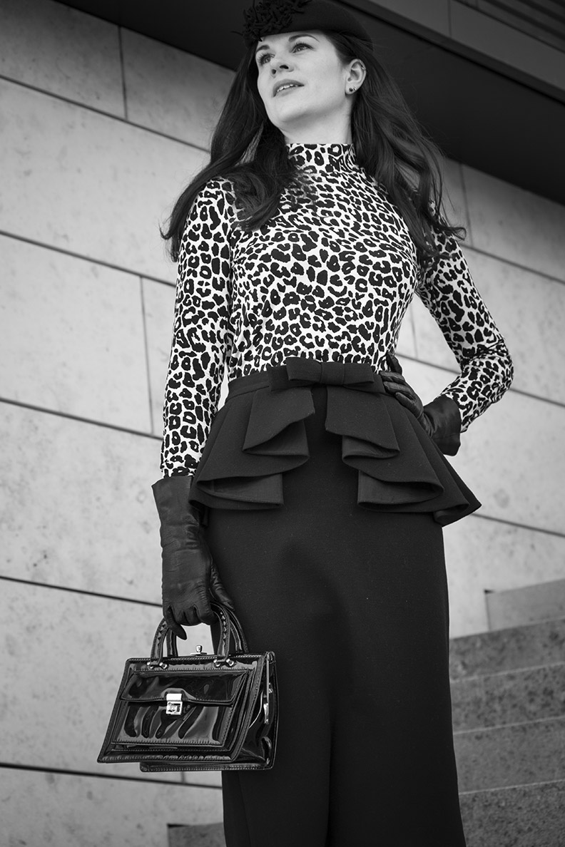 RetroCat wearing a leopard turtleneck and a retro pencil skirt