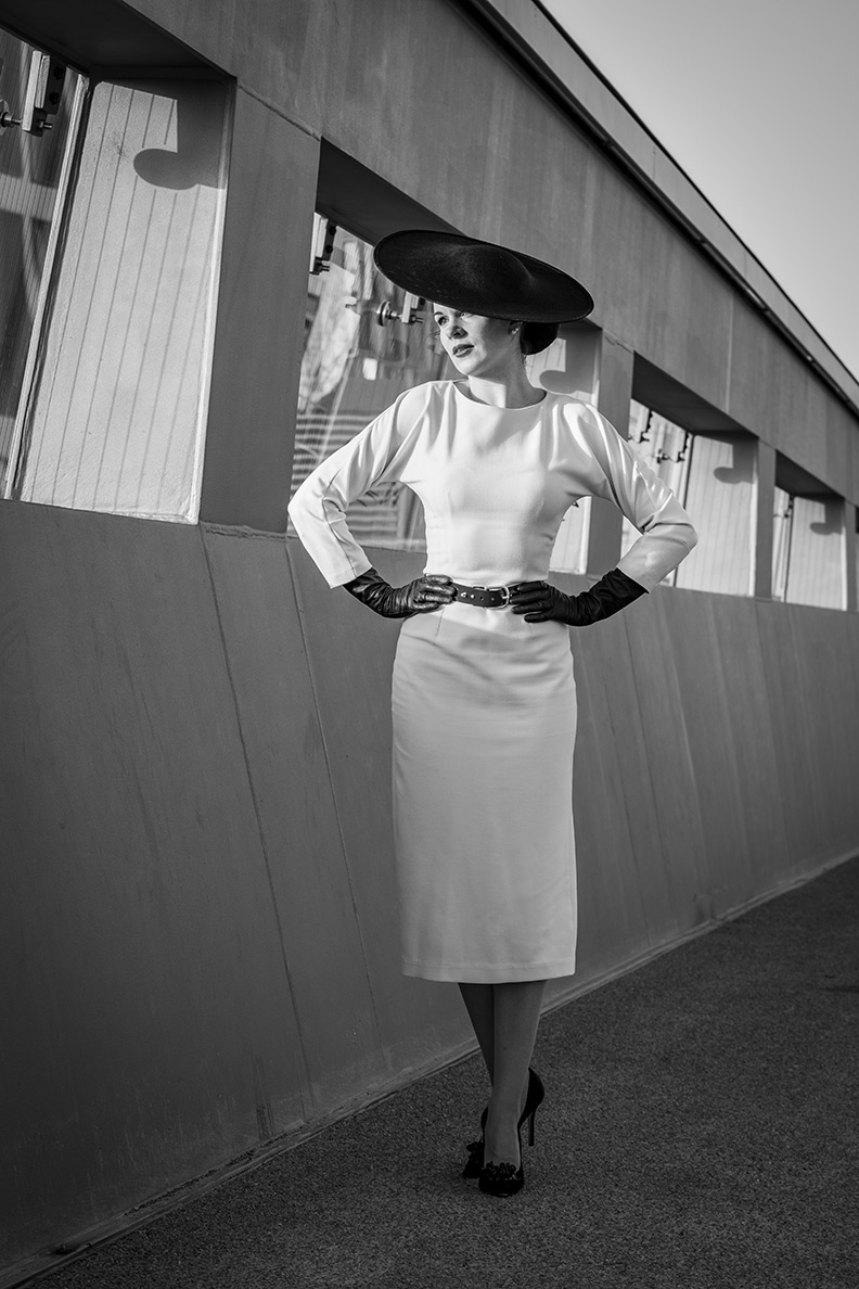 RetroCat wearing a white pencil dress by Ginger Jackie and matching retro accessories