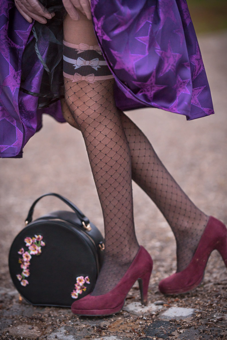 RetroCat wearing fashion tights with a net pattern
