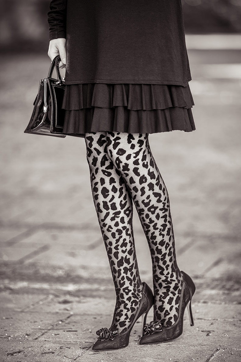 RetroCat wearing tights with leopard print and high heels