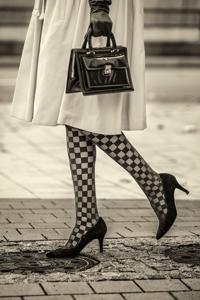 Patterned tights: RetroCat wearing tights with checkerboard pattern
