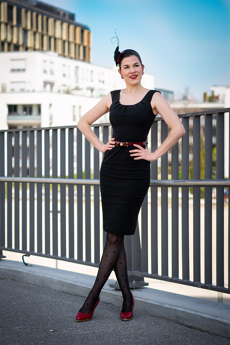 RetroCat wearing a black retro dress by Von 50' and red accessories