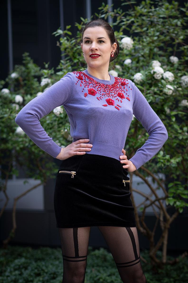 RetroCat wearing a velvet skirt, Miu Miu sweater and cool tights