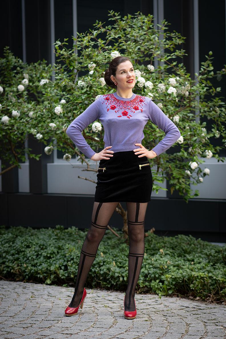 RetroCat wearing a sweater, velvet mini skirt and tights