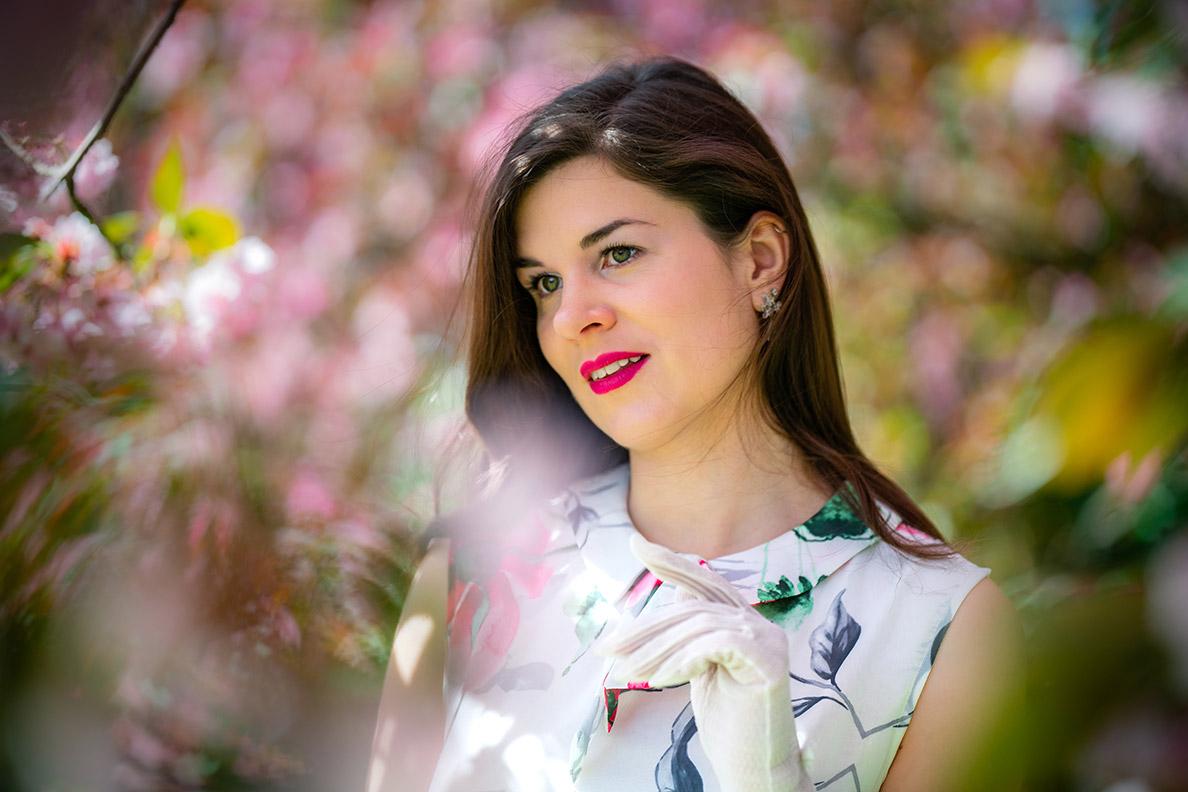 RetroCat wearing pink lipstick with her flower dress in spring