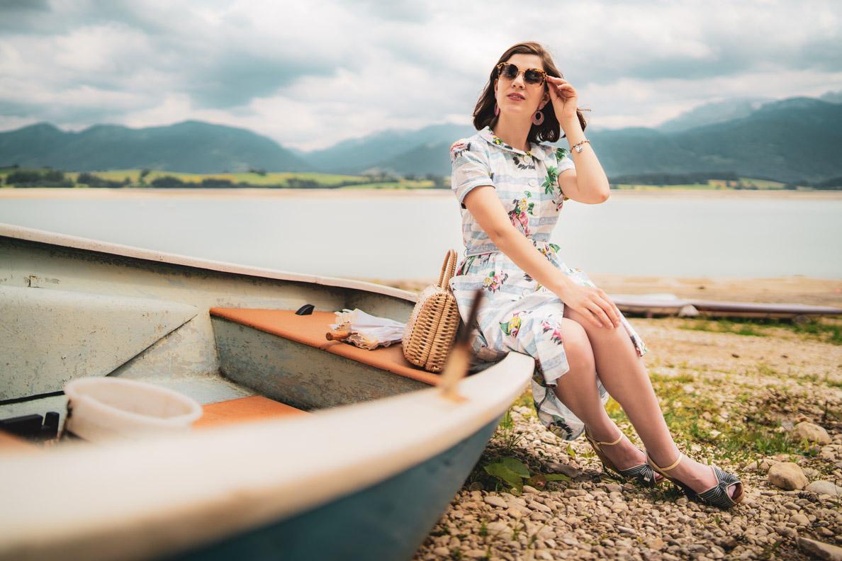 RetroCat wearing a nautical summer dress at the lake