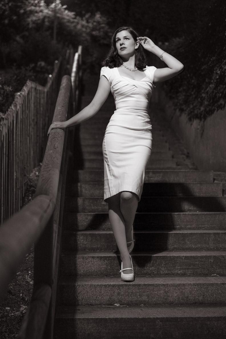 RetroCat wearing a Hollywood-like white dress