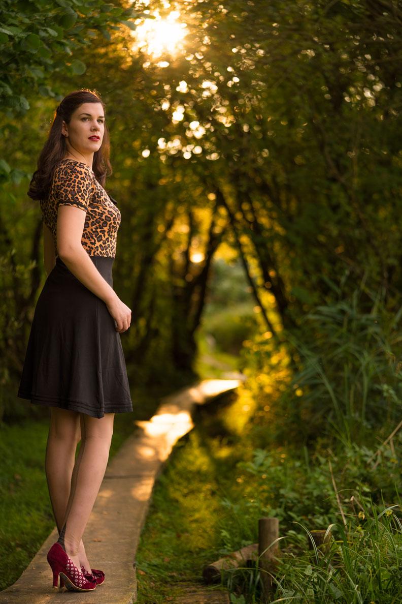 RetroCat wearing a leopard jersey dress in late summer