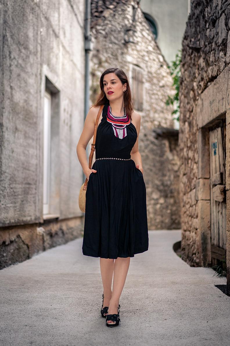 RetroCat wearing a black summer dress with pearl details by Lena Hoschek