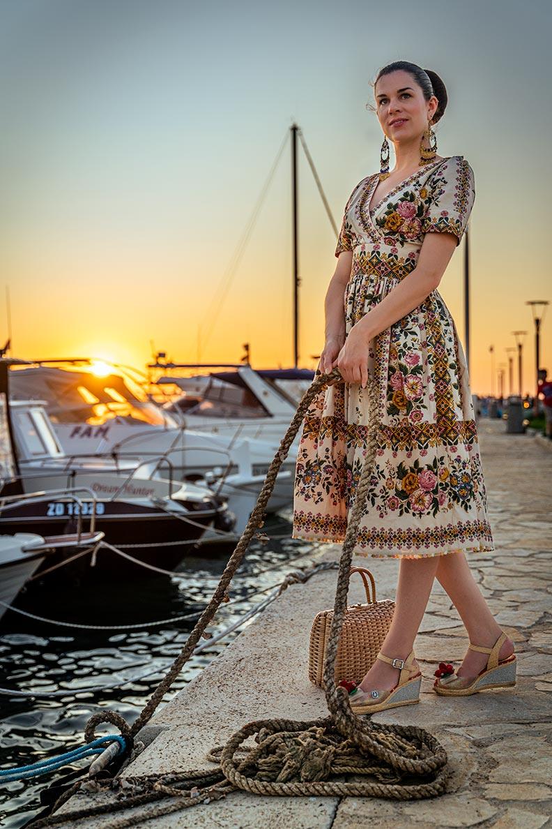 RetroCat wearing a romantic summer dress by Lena Hoschek with a flower pattern
