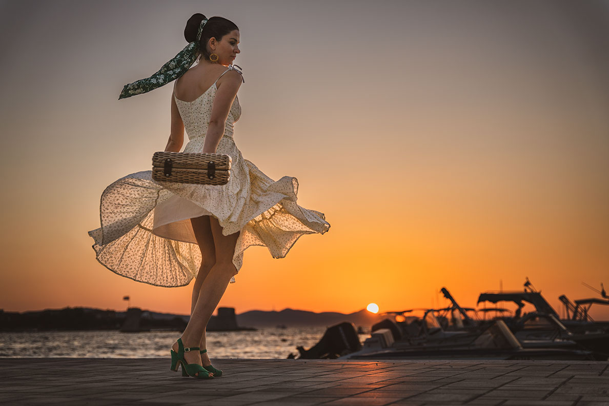RetroCat dancing into sunset wearing a yellow dress by Ginger Jackie